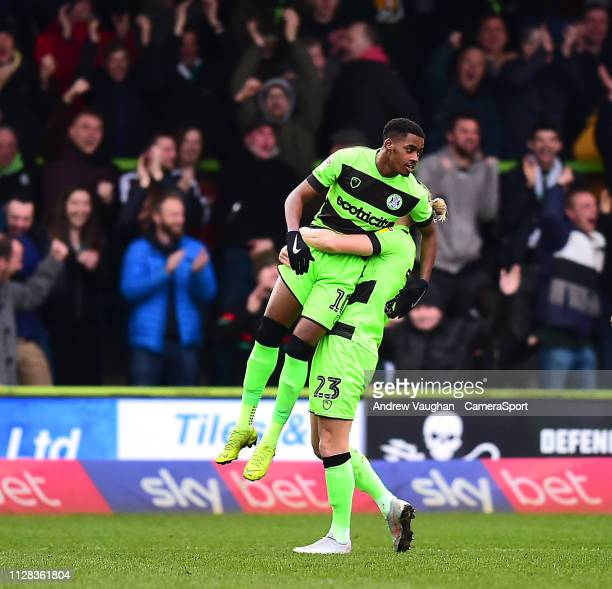 Forest Green Rovers' Reece Brown left celebrates scoring the opening goal with teammate Joseph Mills during the Sky Bet League Two match between...