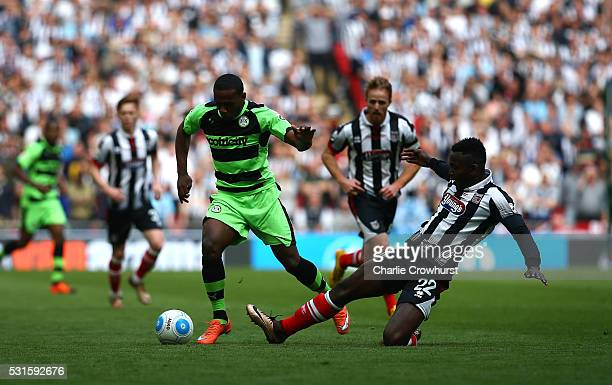 Forest Green's Anthony Jeffery looks to skip the tackle from Grimsby's Aristote Nsiala during the Vanarama Football Conference League Play Off Final...