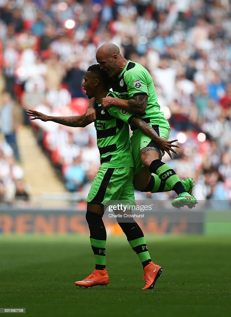 Forest Green's Keanu Marsh-Brown (L) celebrates with David Pipe after pegging a goal back during the Vanarama Football Conference League Play Off Final between Forest Green Rovers and Grimsby Town at Wembley Stadium on May 15, 2016 in London, England.
