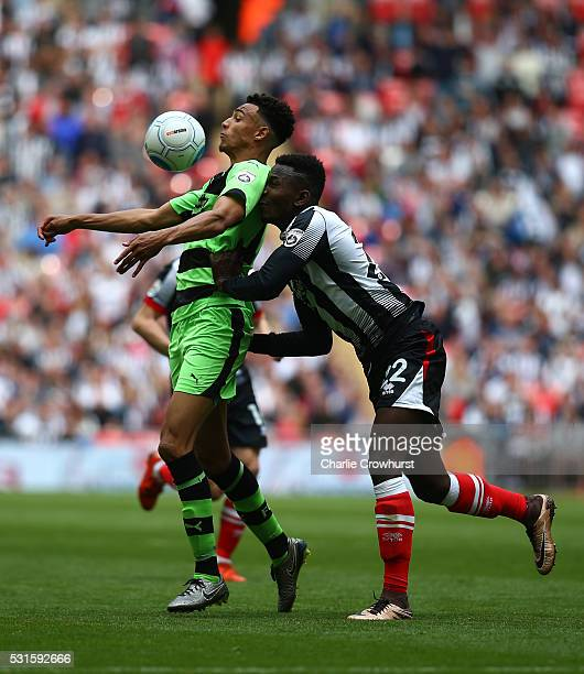 Forest Green's Kurtis Gutrie looks to hold off Grimsby's Aristote Nsiala during the Vanarama Football Conference League Play Off Final between Forest...