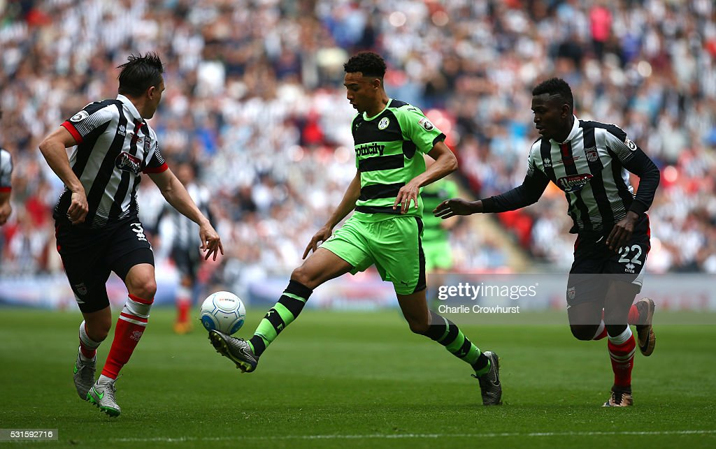 Forest Green's Kurtis Gutrie (L) looks to hold off Grimsby's Aristote Nsiala during the Vanarama Football Conference League Play Off Final between Forest Green Rovers and Grimsby Town at Wembley Stadium on May 15, 2016 in London, England.