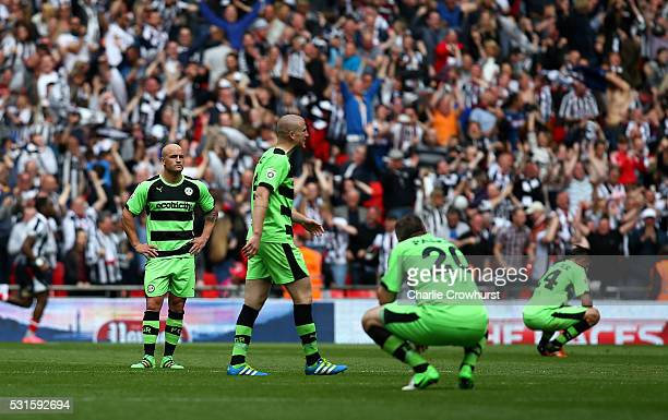 Forest Green's players look dejected after conceding a late third goal during the Vanarama Football Conference League Play Off Final between Forest...