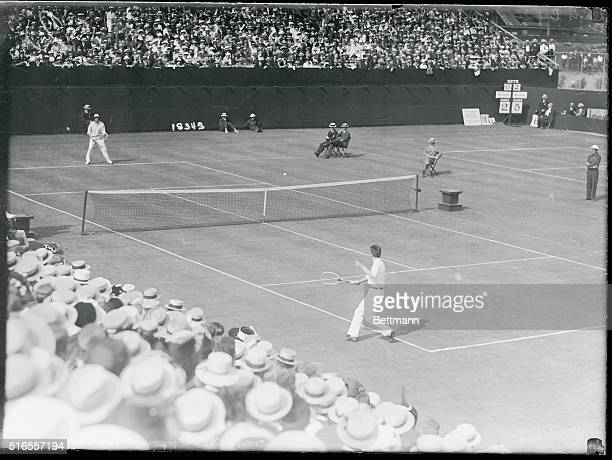 Forest Hills, New York: R. Norris Williams, in foreground, of the American team, opposing A. F. Wilding, of the Australian team, in the first singles...