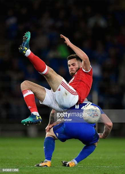 Forest player Danny Fox challenges Aron Gunnarsson of Cardiff during the Sky Bet Championship match between Cardiff City and Nottingham Forest at...