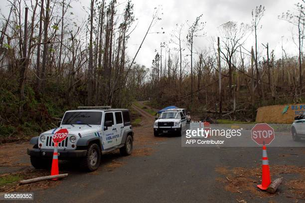 US Forest Service and Puerto Rico Natural Resource vehicles block the entrance of of the closed El Yunque National Forest damaged by the passing of...