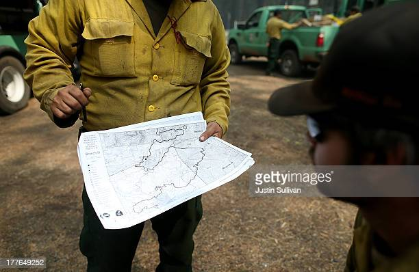 S Forest Service firefighters look at an incident map as they take a break from battling the Rim Fire at Camp Mather on August 25 2013 near Groveland...