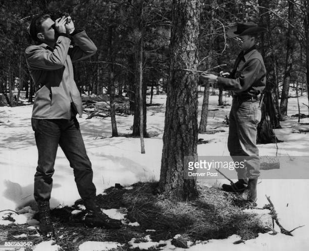 Forest Service Rangers Two Colorado State University forestry students take inventory of forest resources in outdoor classes near Custer SD Pete...