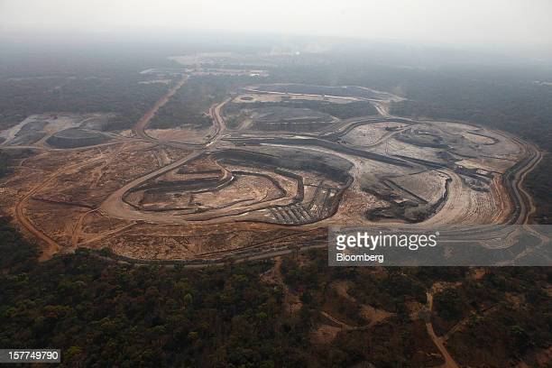 Forest surrounds the open pits of Comide SPRL's Mashitu copper mine operated by Eurasian Natural Resources Corp in this aerial view in Katanga...