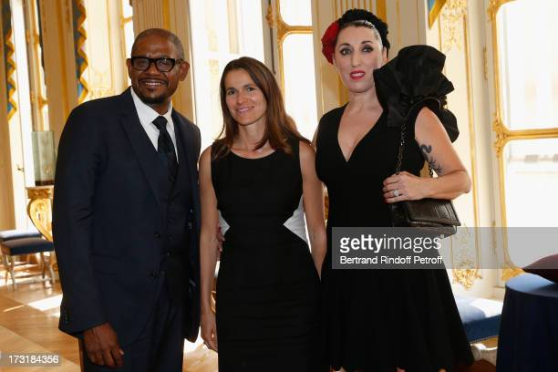Forest Whitaker and Rossy De Palma decorated by Aurelie Filippetti at Ministere de la Culture on July 9 2013 in Paris France