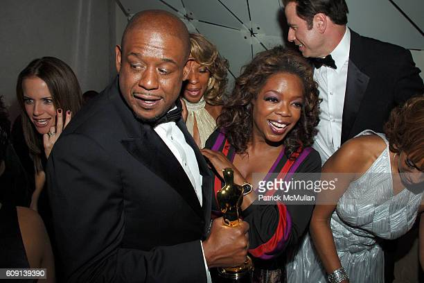 Forest Whitaker Oprah Winfrey John Travolta and Gayle King attend VANITY FAIR Oscar Party at Morton's on February 25 2007 in Los Angeles CA