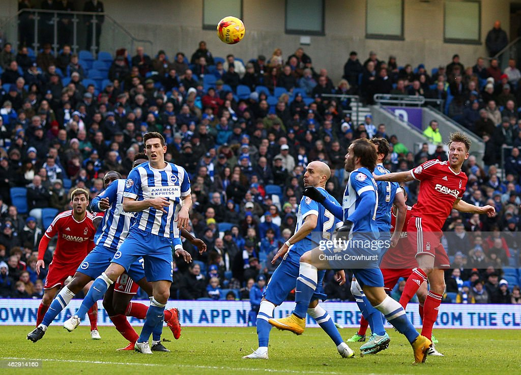 Forest's Danny Collins (R) scores the teams first goal of the game with a header during the Sky Bet Championship match between Brighton & Hove Albion and Nottingham Forest at The Amex Stadium on February 07, 2015 in Brighton, England.