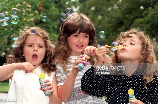 Forever blowing bubblesthree of the finalists in this year's Miss Pears competition blow bubbles out over the Savoy Hotel gardens in London today...