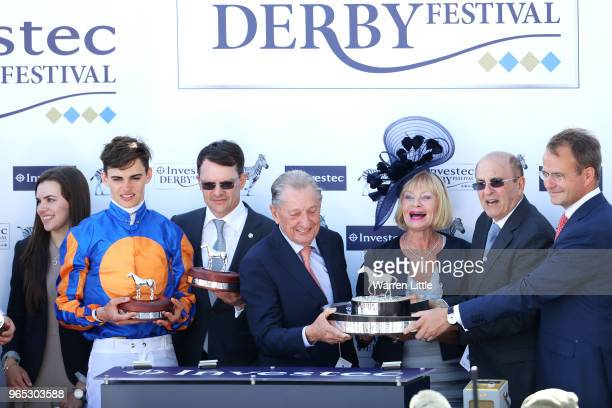Forever Together Jockey Donnacha O'Brien Trainer Aidan O'Brien and part owner Derrick Smith celebrate victory of the Investec Oaks during Ladies Day...