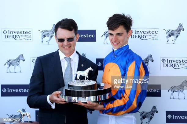 Forever Together Trainer Aidan O'Brien and Jockey Donnacha O'Brien celebrate with the trophy after winning the Investec Oaks during Ladies Day of the...