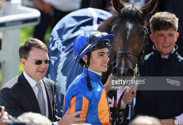 Forever Together Trainer Aidan O'Brien and Jockey Donnacha O'Brien celebrate after winning the Investec Oaks during the Investec Ladies Day at Epsom...