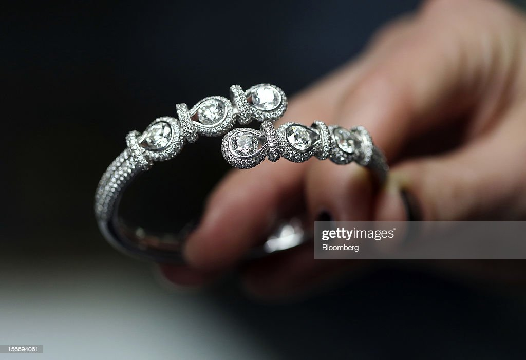 A Forevermark Encodia diamond bracelet, produced by De Beers, is seen at their offices in London, U.K., on Friday, Nov. 16, 2012. De Beers, the biggest diamond producer by revenue, is moving the sorting and trading of rough stones to Botswana from London to secure access to the world's largest supplier of diamonds by value and challenge Antwerp's dominance as the world's biggest trading hub for rough diamonds. Photographer: Chris Ratcliffe/Bloomberg via Getty Images