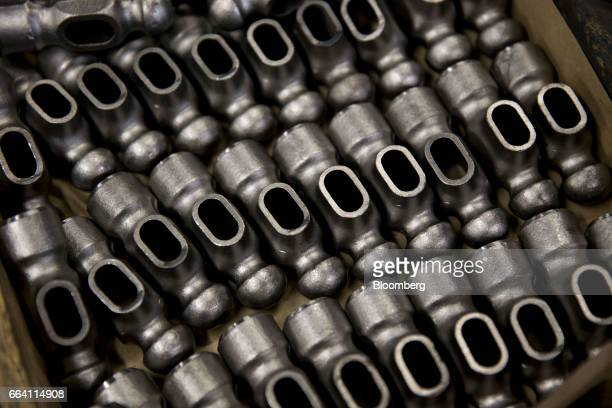 Forged steel ball pein hammer heads sit in a bin at the Vaughan Bushnell Manufacturing Co facility in Bushnell Illinois US on Friday March 31 2017...