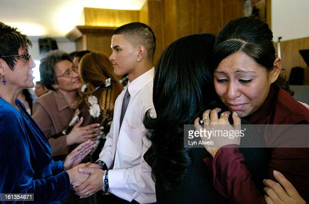 Forgive11CJessica Rubio <cq> right age 22 is hugged by Andrea Garcia <cq> age 41 after a forgiveness worship service held at the Westside Christian...