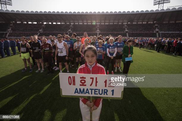 Forign competitors gather during the opening ceremony of the Pyongyang Marathon at Kim IlSung stadium in Pyongyang on April 9 2017 Hundreds of...