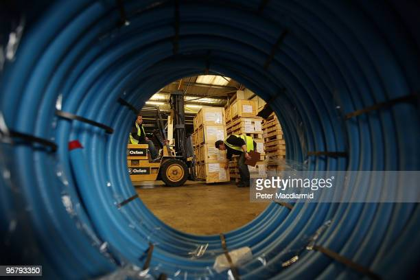 A fork lift truck driver loads water sanitation equipment at Oxfam's logistics warehouse for shipping to Haiti on January 15 2010 in Bicester England...