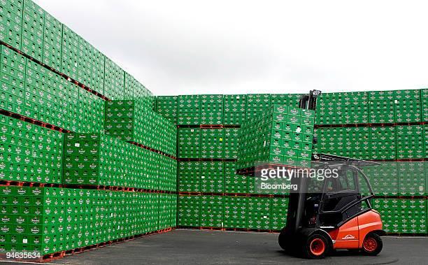 A fork lift truck moves Heineken beer crates at the Heineken brewery in Zoeterwoude The Netherlands Thursday Aug 23 2007 The head on Heineken NV has...