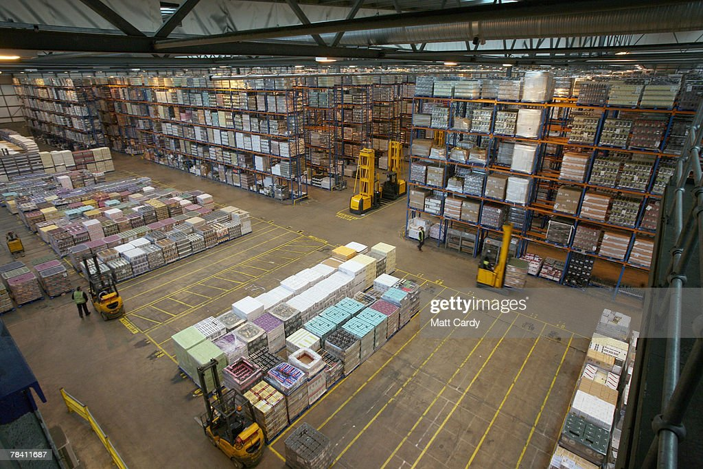 Fork lift trucks move in front of stock about to be sent out at the giant distribution centre in Avonmouth on December 12 2007 near Bristol, England. The giant warehouse, owned by Constellation Europe, is currently packed full of pallets of alcohol to be dispatched - with 90per cent destined for the UK - which means a lorry leaving every seven minutes, 24 hours a day, to keep up with demand.