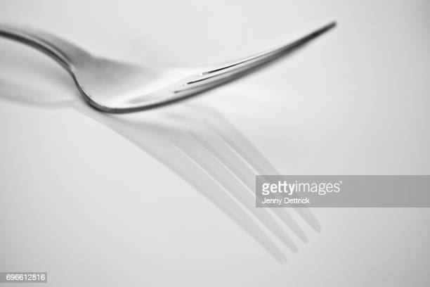 fork reflection - close to stock pictures, royalty-free photos & images