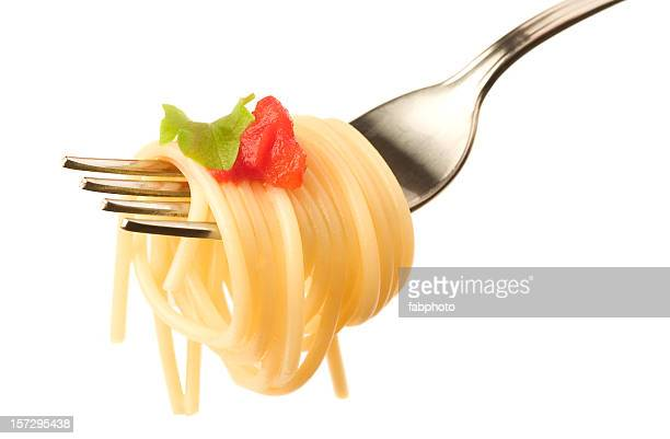 Fork with a bite sized swirl of spaghetti and tomato