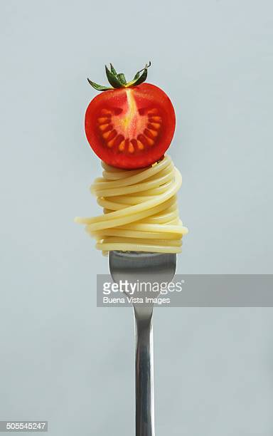 Fork with spaghetti and tomato