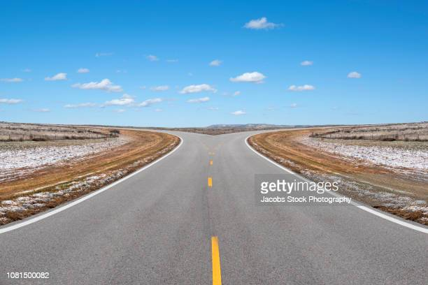 forked road - intersection stock pictures, royalty-free photos & images