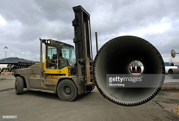 A forklift carries an iron pipe at the SaintGobain factory in PontMousson France on Wednesday Feb 11 2009 French industrial production tumbled for a...
