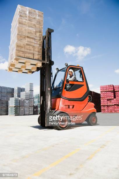 Forklift carrying pallets of cargo
