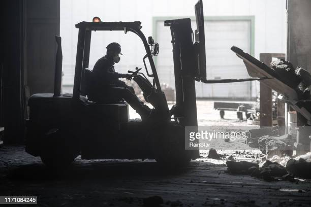 forklift crashed inside factory - forklift stock pictures, royalty-free photos & images