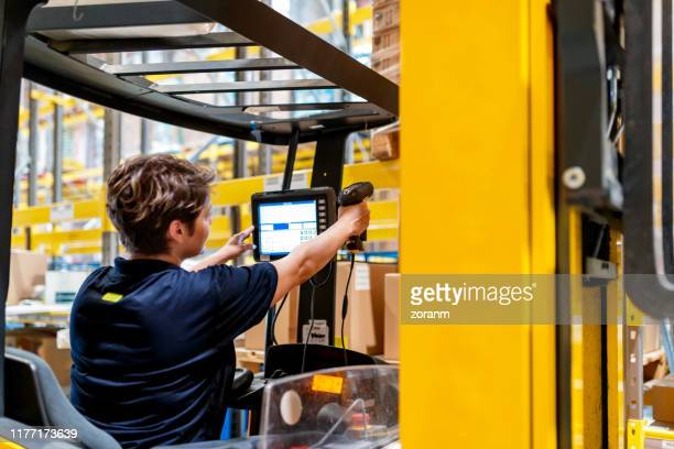 forklift driver aiming at product - part of a series stock pictures, royalty-free photos & images