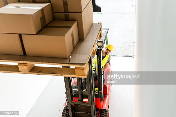 Forklift driver at warehouse