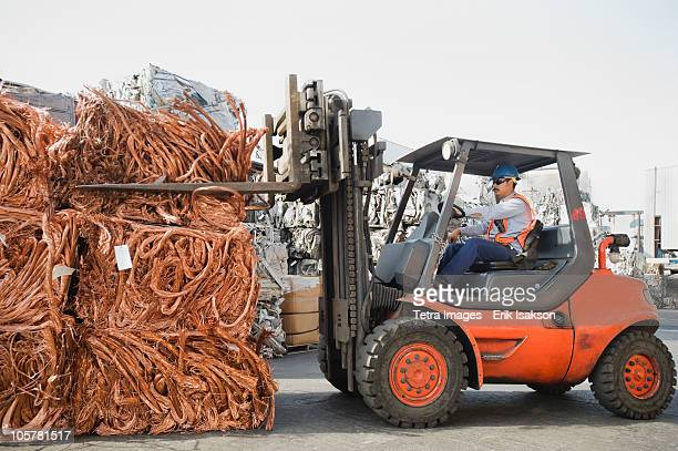 forklift driver working at recycling plant - aluhut stock-fotos und bilder