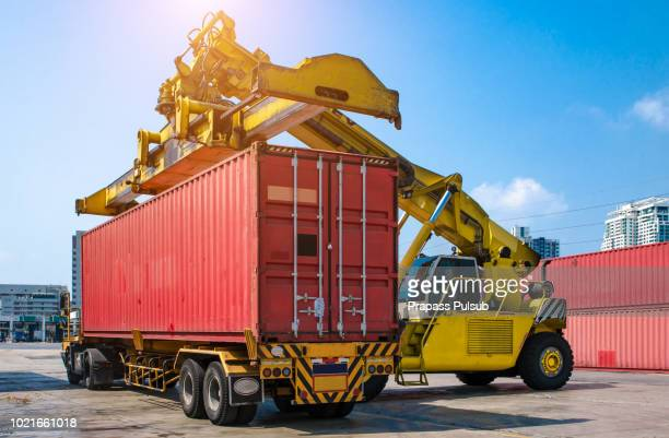 forklift handling the container box in logistic zone - 貨物用コンテナ ストックフォトと画像