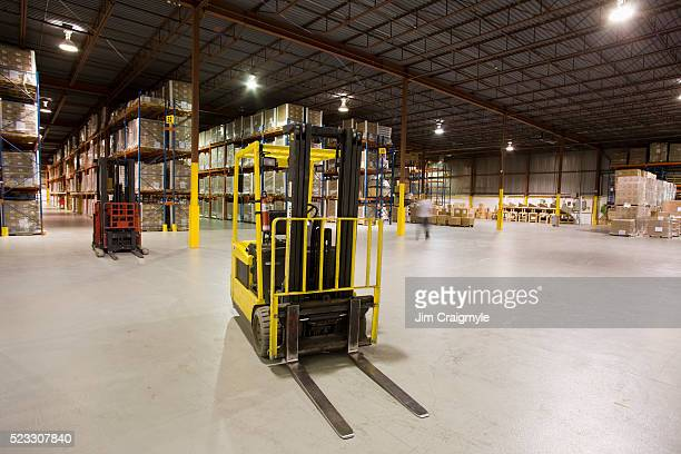 forklift in a warehouse - forklift stock pictures, royalty-free photos & images
