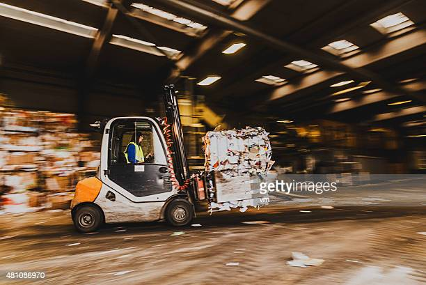Forklift in the garbage dump with female driver