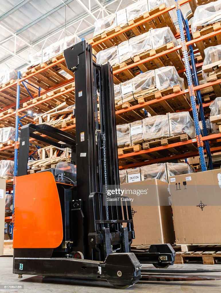 Forklift in the modern warehouse : Stock Photo