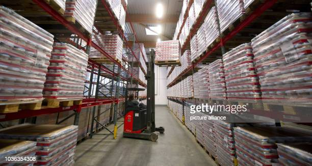 A forklift loads a pallet in the picking hall of mustard company Bautz'ner Senf Feinkost GmbH in Bautzen Germany 21 November 2013 The Bautzen company...