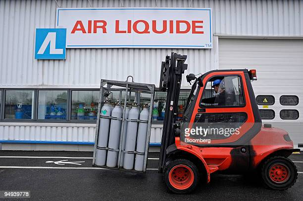 A forklift loads bottles of gas at the Air Liquide factory in Moissy Cramayel France on Friday Feb 13 2009 Air Liquide SA the world's biggest maker...
