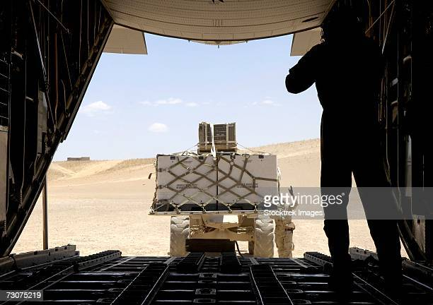 A forklift loads cargo onto a C-130 Hercules on a dirt runway in Tarin Kowt, Afghanistan, on Wednesday, June 14.