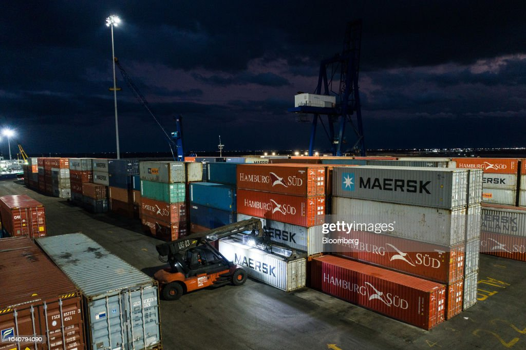 A forklift loads shipping containers at the APM terminal of