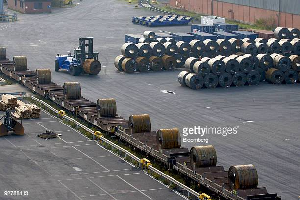 Forklift loads steel rolls on to a railway cart ready for transportation at an ArcelorMittal steel plant in Bremen, Germany, on Wednesday, Nov. 4,...