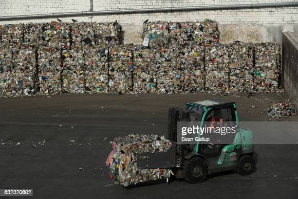 A forklift moves a bale of sorted materials at the ALBA sorting center for the recycling of packaging materials on August 15 2017 in Berlin Germany...