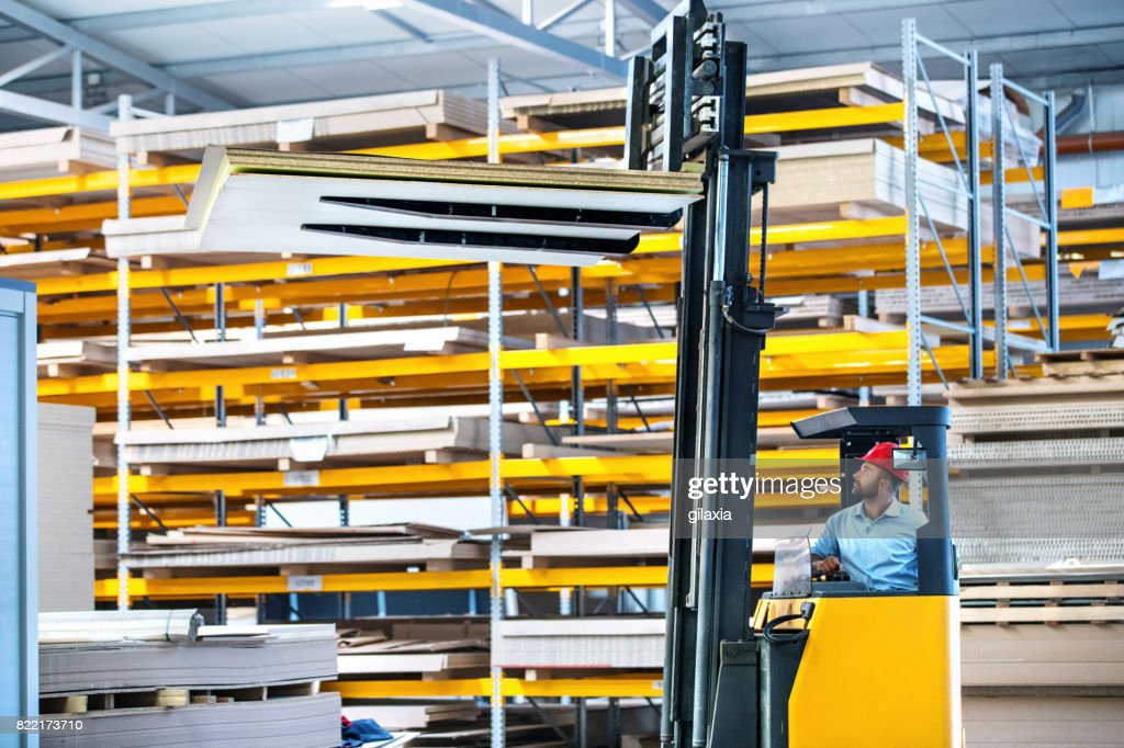 Forklift operator at a distribution warehouse : Stock Photo