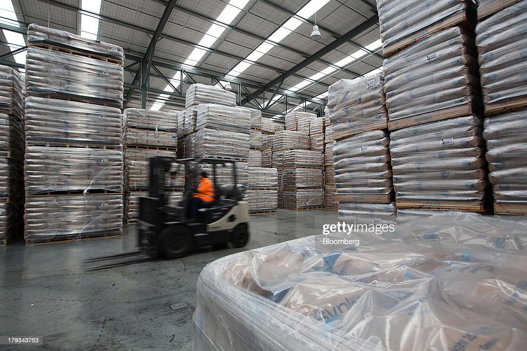 A forklift operator drives past bags of milk powder stored inside the warehouse at Synlait Milk Ltd.'s manufacturing plant in the town of Rakaia, 60km from Christchurch, New Zealand, on Friday, Aug. 30, 2013. Synlait, a unit of Shanghai-based Bright Dairy & Food Co., will process more milk than forecast in 2013-14, the company announced on Aug. 30. Photographer: Brendon O'Hagan/Bloomberg via Getty Images