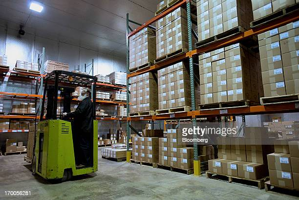 A forklift operator loads pallets of cheese for orders inside the warehouse at Heini's Cheese production facility in Berlin Ohio US on Thursday June...