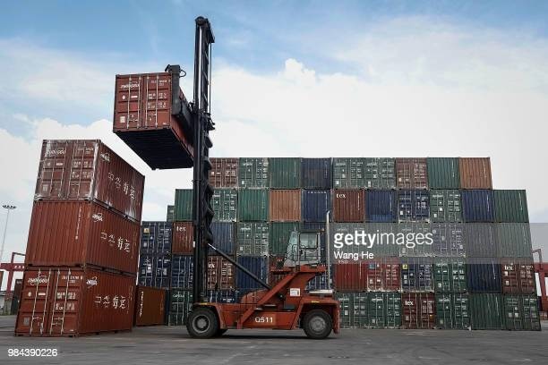 A forklift transport at a Yangluo container port on the Yangtze River on June 26 2018 in WuhanHubei province China Wuhan New Port comprises four...